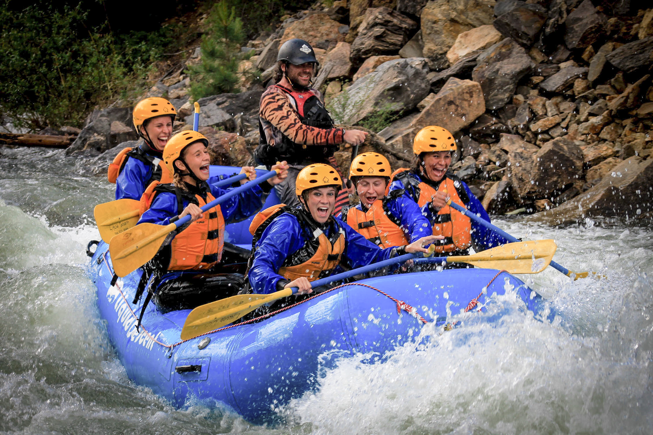 Rafters brace themselves in heavy rapids.