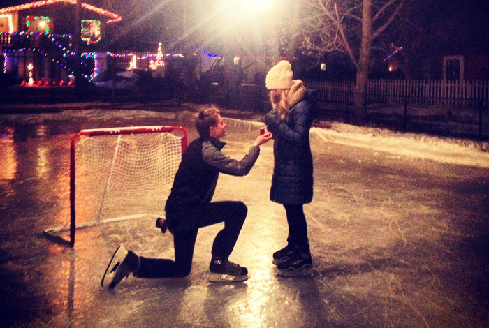 Man proposed marriage to a women on an outdoor ice skating rink.